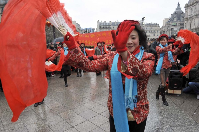 Performers dance in front of Paris City Hall to celebrate Chinese New Year on February 10, 2013, before parading in Paris' streets. Chinese communities world wide traditionally welcomed in the 'Year of the Snake'. (Medhi Fedouach/AFP/Getty Images)
