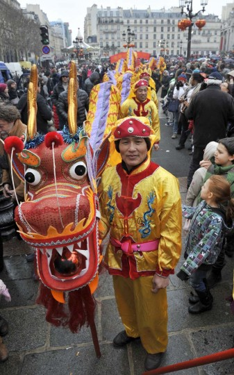 Performers hold a dragon during a parade as they celebrate Chinese New Year on February 10, 2013 in Paris. Chinese communities world wide traditionally welcomed in the 'Year of the Snake'. (Medhi Fedouach/AFP/Getty Images)