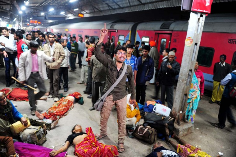 A man denounces the police as the cause of the stampede that killed one of his relative at the main railway station serving India's giant Kumbh Mela festival, in Allahabad on February 10, 2013. At least 10 people died in the stampede and dozens more were injured in the crush. Some local television channels put the death toll as high as 20. Local officials said that the railings on a bridge at Allahabad station had given way under the pressure of the mass of people, while eyewitnesses told local media that the police had baton-charged the crowd leading to panic. (Sanjay Kanojia/AFP/Getty Images)