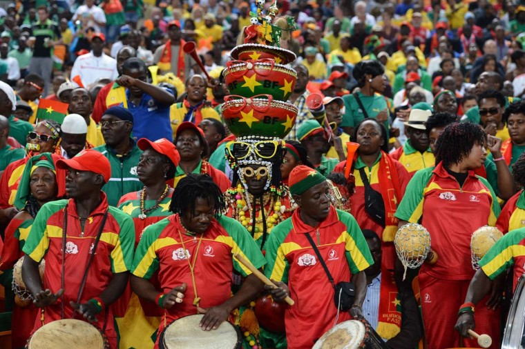 Burkina Faso's national football team supporters play drums ahead of the kick off of the 2013 African Cup of Nations final football match between Burkina Faso and Nigeria on February 10, 2013 at Soccer City stadium in Johannesburg. (Francisco Leong/AFP/Getty Images)