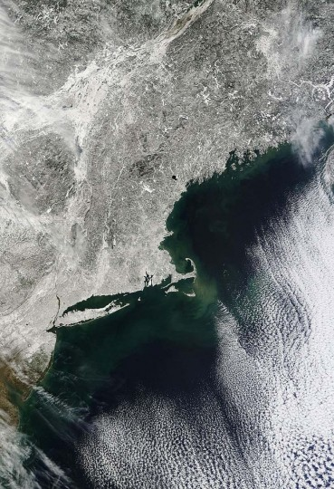 This February 10, 2013 NASA Terra satellite image, shows snow covering the northeastern US. The US northeast slowly dug out early Sunday from a mammoth blizzard that choked air, road and rail travel, left some 650,000 homes and businesses without power and caused at least seven deaths. The storm, which hit New York and other areas still scarred by Superstorm Sandy back in October, dumped as much as three feet of snow across New England, with hurricane-strength gusts helping to create massive drifts. New York and Long Island can be seen in the lower half of the image. (NASA HO via AFP/Getty Images)