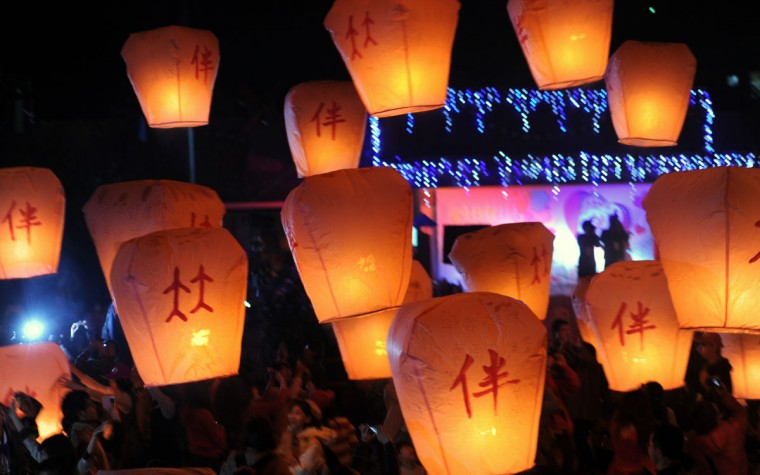 Local residents release sky lanterns in Pingshi, New Taipei City, Taiwan, on the fifth day of the lunar new year on February 14, 2013. At least 600 couples celebrated their Valentine's Day via releasing sky lanterns. (Sam Yeh/AFP/Getty Images)