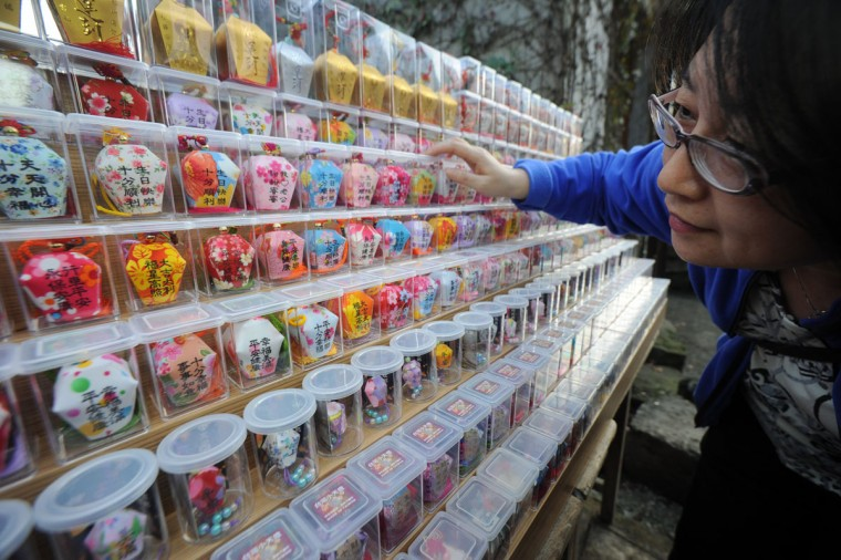 A woman looks at the models of sky lanterns in Pingshi, New Taipei City, Taiwan, on the fifth day of the lunar new year on February 14, 2013. (Sam Yeh/AFP/Getty Images)