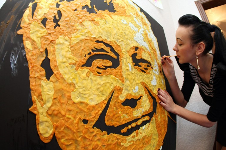 Young Ukrainian painter Anna-Sofiya Matveeva, 22, uses chewed chewing gum during her work to create a portret of the football club Shakhtar coach Mircea Lucescu in her studio in small Ukrainian city of Makiyivka. Some 800 chewed chewing gums were used for the the creation, some 1000 chewing gums - for the portrait of Steve Jobs made one month before and the 500 gums for the portrait of British rock-star Elton John. (Alexander Khudoteply/AFP/Getty Images)