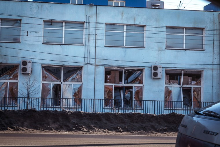 A view of the facade of a local paint and varnish plant that was damaged by a shockwave from a meteor in the Urals city of Chelyabinsk, on February 15, 2013. Buildings were damaged after a meteorite shot across the sky and exploded over central Russia on Friday. (Oleg Kargopolov/AFP/Getty Images)