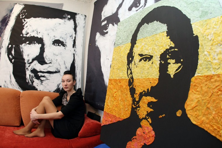 Ukrainian painter Anna-Sofiya Matveeva, 22, sits on a sofa in her studio with her cerations which she makes with chewed chewing gum in the small Ukrainian city of Makiyivka. (Alexander Khudoteply/AFP/Getty Images)