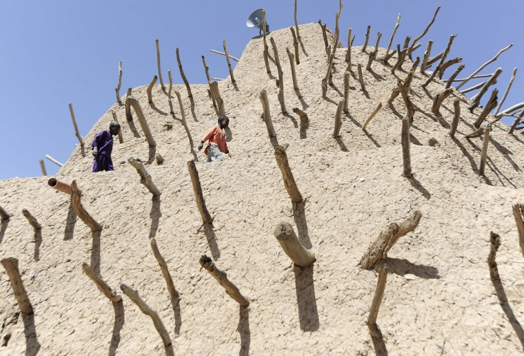 Children play beside the tomb of the Askia in Gao, northern Mali. The European Union on Friday announced fresh aid worth 20 million euros to help restore law and order in Mali as well as the return of basic state services such as education after months of trouble. (Pascal Guyot/AFP/Getty Images)