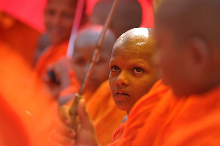 Young Sri Lankan Buddhist monks takes part in a rally calling for a ban on Islamic halal-slaughtered meat at Maharagama, a suburb of the capital Colombo, February 17, 2013. (Ishara S. Kodikara/AFP/Getty Images)