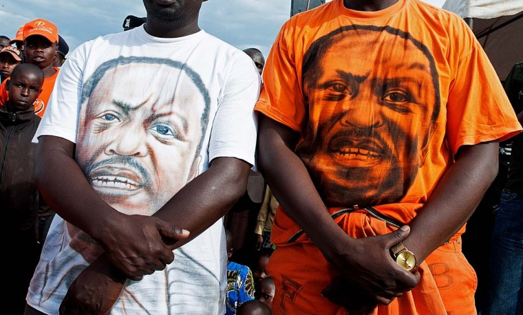 Members of the 'Youth 4 Raila' political supporters group, wear t-shirts bearing presidential candidate Raila Odinga's face during a rally in Bomet, in the Rift Valley on February 17, 2013. Odinga and his ODM party were campaigning in the area as part of the CORD Coalition ahead of the country's March 4, 2013 elections. (Will Boase/AFP/Getty Images)