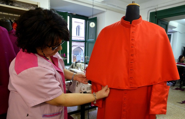 An employee prepares a cardinal's vest at Gammarelli ecclesiastical tailoring in Rome on February 21, 2013. The tailors are expected to be already creating sumptuous vestments for the new pope in small, medium and large sizes so that whoever is chosen will fit right into the clothes. (Alberto Pizzoli/AFP/Getty Images)