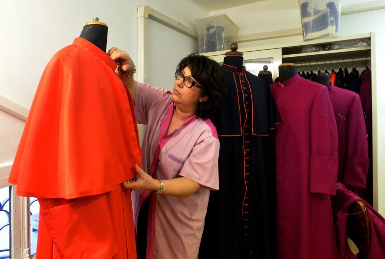 An employee prepares a cardinal's vest at Gammarelli ecclesiastical tailoring in Rome on February 21, 2013. The tailors are expected to be already creating sumptuous vestments for the new pope in small, medium and large sizes so that whoever is chosen will fit right into the clothes. (Alberto Pizzoli/AFP/ Getty Images)