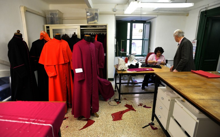 An employee works at Gammarelli ecclesiastical tailoring in Rome on February 21, 2013. The tailors are expected to be already creating sumptuous vestments for the new pope in small, medium and large sizes so that whoever is chosen will fit right into the clothes. (Alberto Pizzoli/AFP/Getty Images)