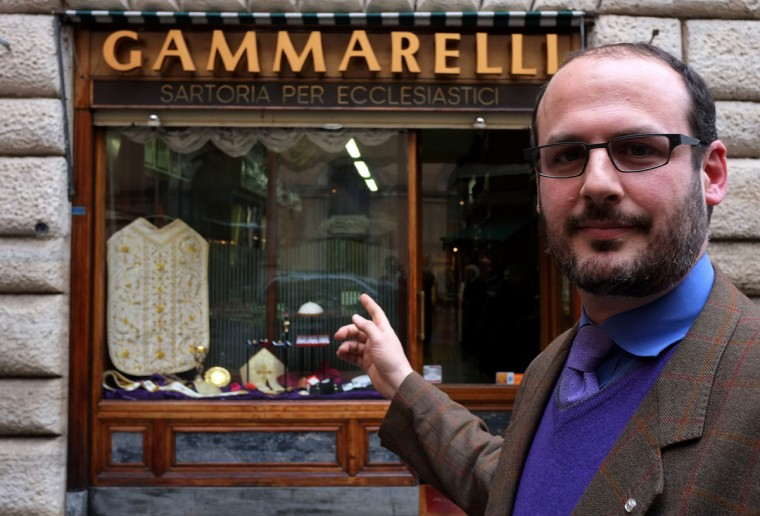 Lorenzo Gammarelli poses in front of Gammarelli ecclesiastical tailoring in Rome on February 21, 2013. The tailors at Gammarelli ecclesiastical tailoring are expected to be already creating sumptuous vestments for the new pope in small, medium and large sizes so that whoever is chosen will fit right into the clothes. Six generations of Gammarelli's have served thousands of priests, and hundreds of Bishops and Cardinals and Pontiffs. (Alberto Pizzolo/AFP/Getty Images)