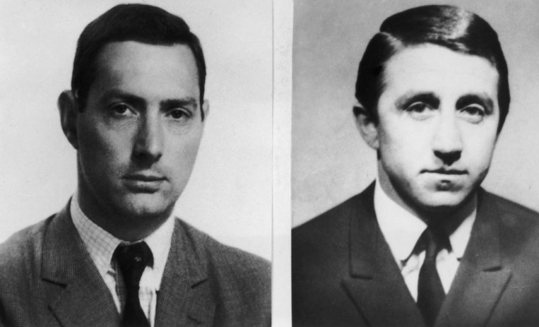 August 27, 1963: Photos issued by Scotland Yard of great train robbers Bruce Reynolds (left) and Roy James in the aftermath of the 2.6 million pound train robbery committed on 8th August 1963. (Keystone/Hulton Archive/Getty Images)