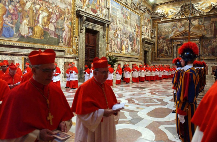 Cardinals gather before the start of the conclave at the Sistine Chapel at the Vatican on April 18, 2005. Shut away from the eyes of the world, Roman Catholic cardinals opened a days-long conclave of ancient tradition and utmost secrecy to elect one of their number as their 265th pope. (Arturo Mari/AFP/Getty Images)