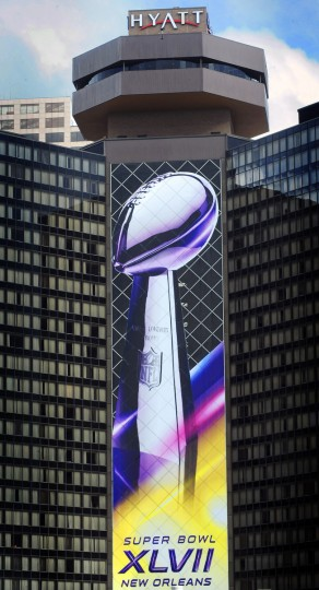 Following a trend started in the Salt Lake City Olympics, buildings in the downtown New Oleans area are displaying huge Super Bowl banners. Scenes in New Orleans around the upcoming Super Bowl. (Gene Sweeney Jr./Baltimore Sun)