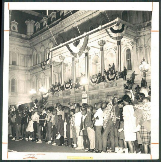 1966 — Birds Forever fans at City Hall gather to catch a glimpse of the parade to honor the Orioles who won the American League Championship and World Series that year. (Baltimore Sun)