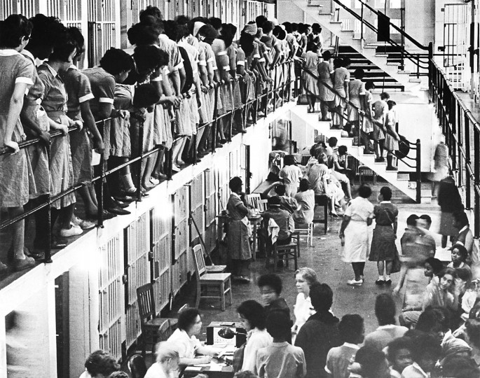 Feb. 21, 1963. Crowded women's quarters at the City Jail held 208 prisoners last night as Northwood Theater demonstrators jammed the section past its theoretical capacity of 140. Lt. James craig said, 'We don't hardly have any room.' -- This photo was published under the headline 'Squeezed In.' (William Mortimer/Baltimore Sun)