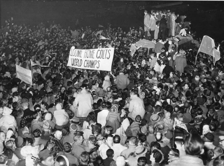Dec. 29, 1958 — A huge crowd of 30,000 estimated fans greeted the Baltimore Colts as they arrived at Friendship International Airport welcoming the Colts after their National Football League Championship win. (Associated Press File Photo)