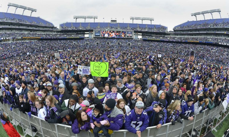 Fan gather on the field at M&T Bank Stadium in the hours before a celebration of the Baltimore Ravens Super Bowl win on Tuesday, February 5, 2013. (Doug Kapustin/Baltimore Sun)