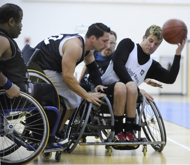 Mike Shaffer, center, lunges towards Ryan Henderson, trying for the ball during practice for the Maryland Ravens wheelchair basketball team. (Gene Sweeney Jr./Baltimore Sun)
