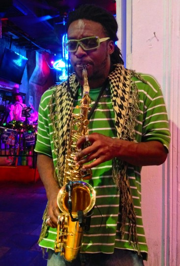 Reginold Smith plays the sax along Bourbon Street in the French Quarter of New Orleans for tips. (Gene Sweeney Jr./Baltimore Sun)