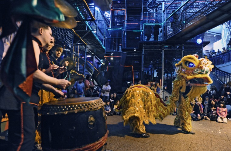 Chinese lion dancers perform for over 1500 children and parents who join in the celebration of Chinese New Year, the Year of the Snake, at Port Discovery Children's Museum. (Kenneth K. Lam/Baltimore Sun)