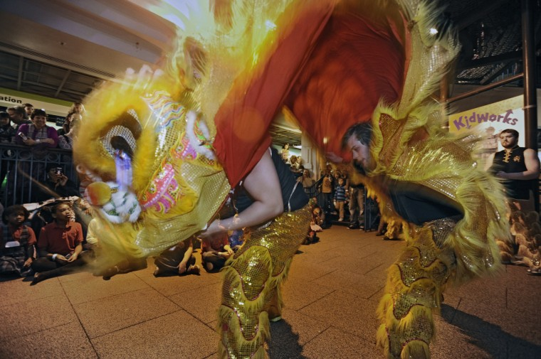 Lion dancers perform for children and parents as part of the celebration of Chinese New Year, the Year of the Snake. (Kenneth K. Lam/Baltimore Sun)