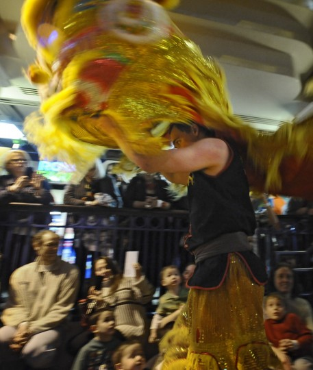 A dance performer entertains the children and parents who came to Port Discovery Children's Museum to join in the celebration of Chinese New Year. (Kenneth K. Lam/Baltimore Sun)
