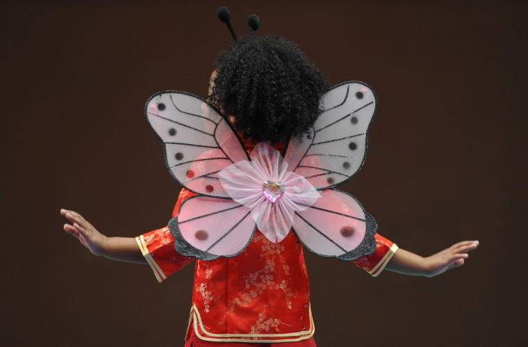 Amaya Torres, 5, a kindergartener at Baltimore International Academy, dances as a butterfly while performing in a Chinese New Year program at Port Discovery. (Kenneth K. Lam/Baltimore Sun)