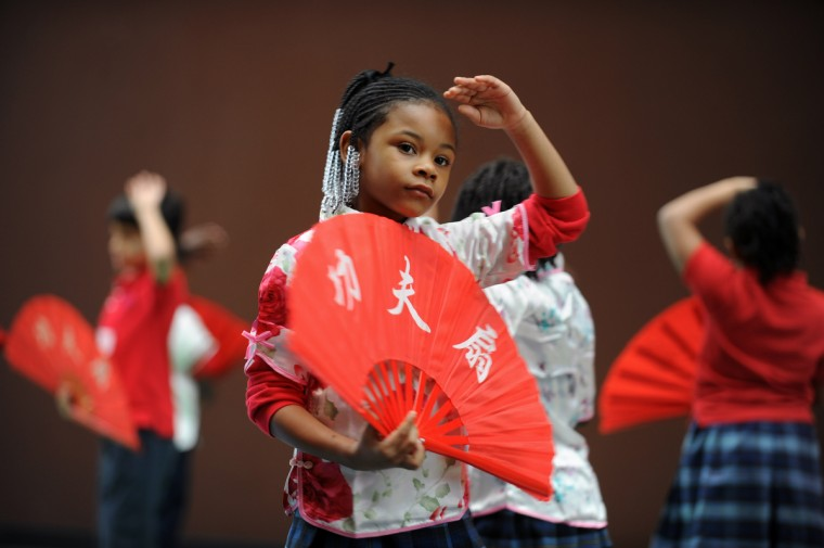 Ariel Nealy, 6, a kindergartener at Baltimore International Academy, performs the Kung Fu Fan dance with classmates during the school's Chinese New Year performance. (Kenneth K. Lam/Baltimore Sun)