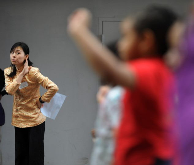 Xiao Xia Zhang (cq), left, the Chinese immersion co-ordinator at Baltimore International Academy, leads her students in performing mandarin songs and dances during the celebration of Chinese New Year, the Year of the Snake. Over 1500 children and parents attended the event on the seventh day of usually a 15 days celebration of the new year. (Kenneth K. Lam/Baltimore Sun)