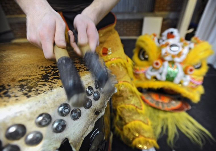 The drummer plays the edge of the kettledrum for a higher pitch sound during the lion dance. (Kenneth K. Lam/Baltimore Sun)