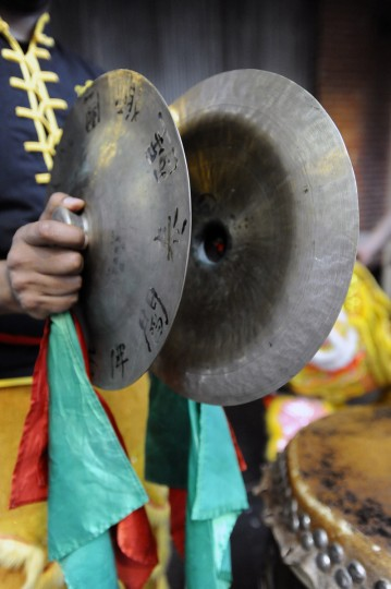 A pair of cymbals are played during the performance of the traditional lion dance. (Kenneth K. Lam/Baltimore Sun)