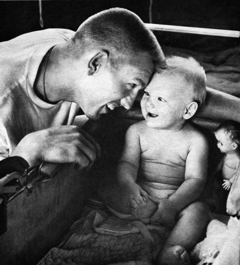 September, 1960 - Johnny Unitas plays with his 9-month-old son Chris at his home near Towson MD. Richard Stacks/Baltimore Sun