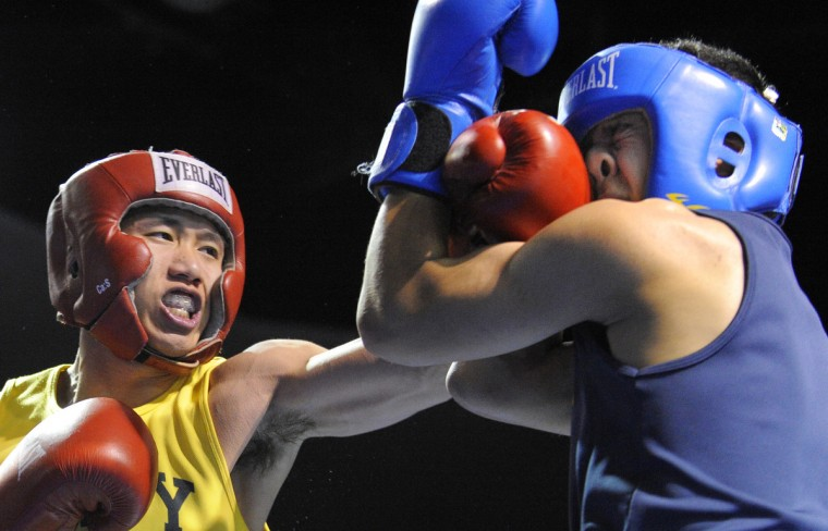 Hlan Thaw, left, lands a punch to the face of Dan O'Neill in the 132 pound weight class. (Lloyd Fox/Baltimore Sun)