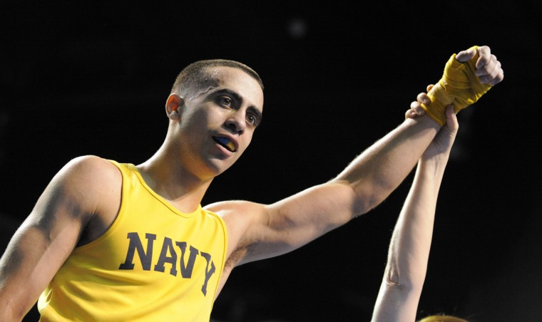 Midshipman Jim Lawson gets the victory in the 139 pound weight class. (Lloyd Fox/Baltimore Sun)