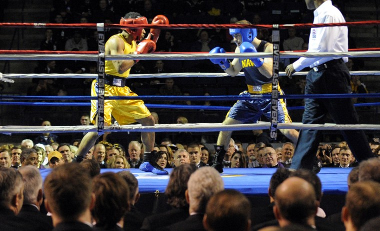 Midshipmen Andre Moorehead, left, and MIke Mourafetis compete in the 147 pound weight class. (Lloyd Fox/Baltimore Sun)