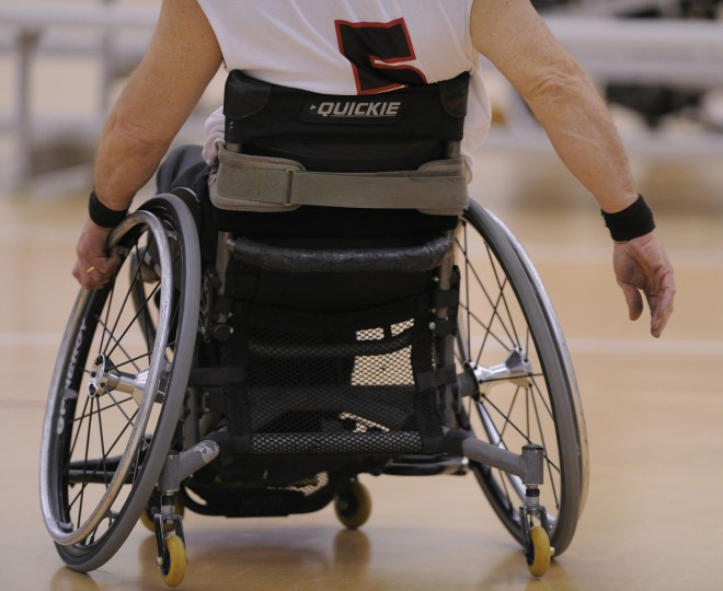 Ron Shaffer, who was injuried in a Motocross accident, maneuvers his chair down the court during practice of Maryland Ravens wheelchair basketball team. (Gene Sweeney Jr./Baltimore Sun)