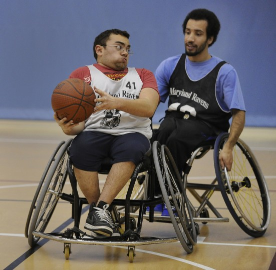 Theodore Luster, Jr., left, tries to get around teammate Derry Hill during practice. (Gene Sweeney Jr./Baltimore Sun)