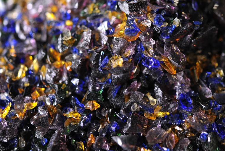 A detail photograph of small pieces of colored glass known as frit. (Lloyd Fox/Baltimore Sun)