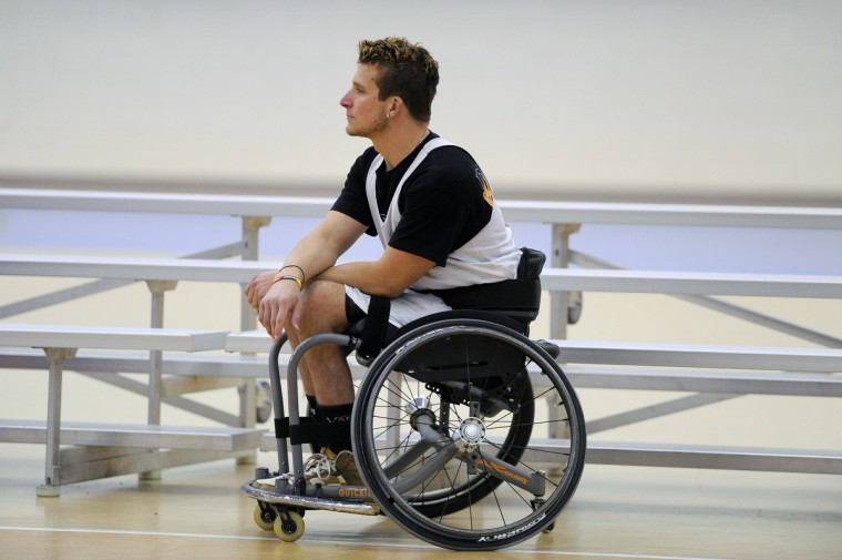 Ryan Henderson, who was injuried in a motorcycle racing accident, watches practice of Maryland Ravens wheelchair basketball team. (Gene Sweeney Jr./Baltimore Sun)