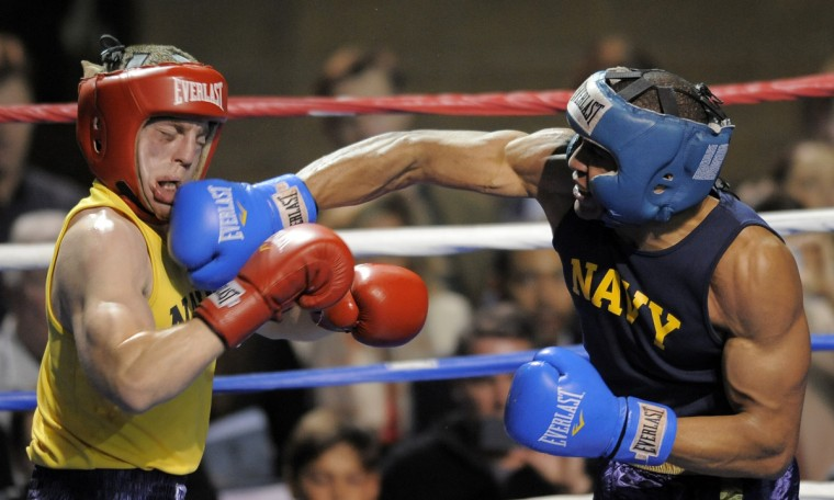 Cody Cordero, left, is hit by fellow midshipman Anthony Alexander in the 185 pound weight class. (Lloyd Fox/Baltimore Sun)