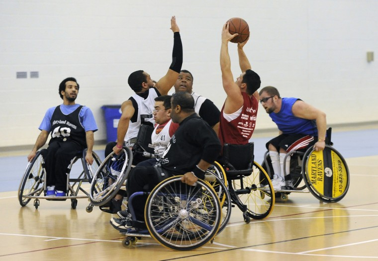 Adrien Burnett tries for the block on Mike Shaffer's shot during practice of the Maryland Ravens, the number 1 ranked Division III wheelchair basketball team in the country. (Gene Sweeney Jr./Baltimore Sun)