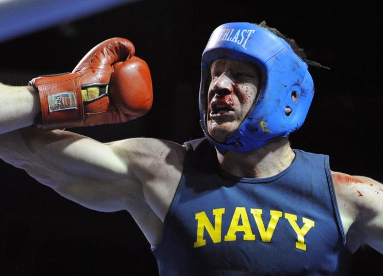 Midshipman Matt Brewer fought through a bloody nose to win the heavyweight division. (Lloyd Fox/Baltimore Sun)
