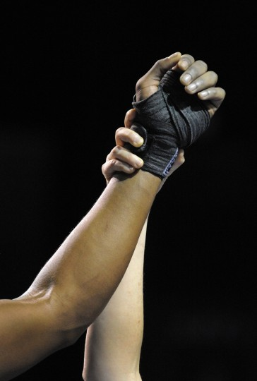Keon Briscoe has his hand raised after winning the 195 pound weight class bout. (Lloyd Fox/Baltimore Sun)