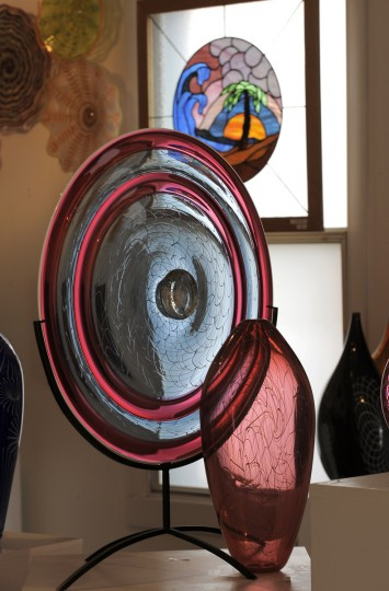 A finished glass dish and other glass sculptures by Tim McFadden. (Lloyd Fox/Baltimore Sun)