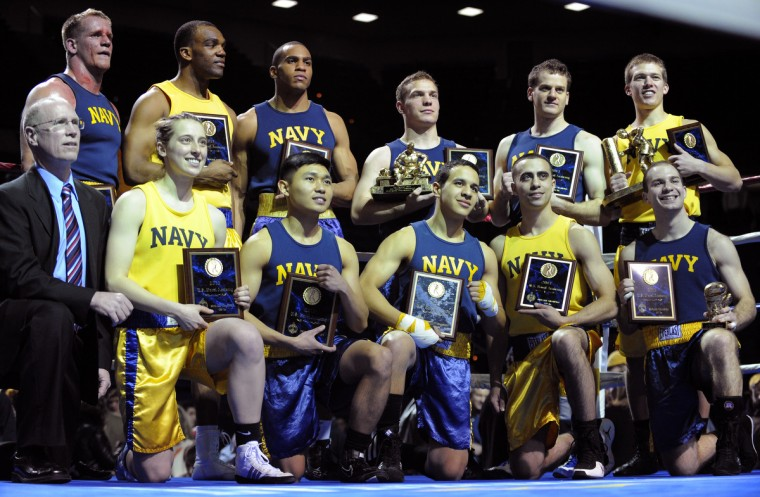 Midshipmen cheer for Mike Mourafetis who won the 147 pound weight class. The United States Naval Academy holds its 72nd annual Brigade Boxing Championships held at Alumni Hall. As part of the academy's physical education all midshipmen are required to participate in boxing. Boxing is also offered as a club sport. (Lloyd Fox/Baltimore Sun)
