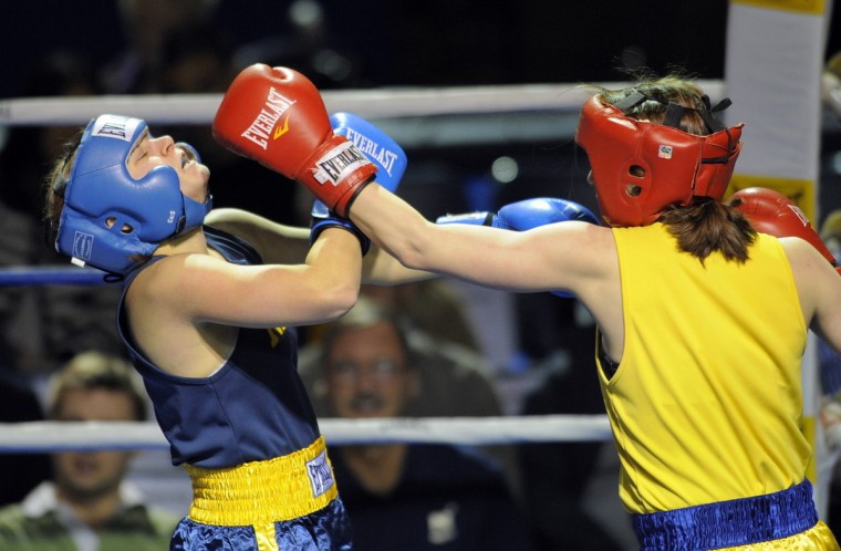 In the only women's bout L-R Abby Khushf (CQ) is hit by the winner of the bout, Sam Glaeser. (Lloyd Fox/Baltimore Sun)