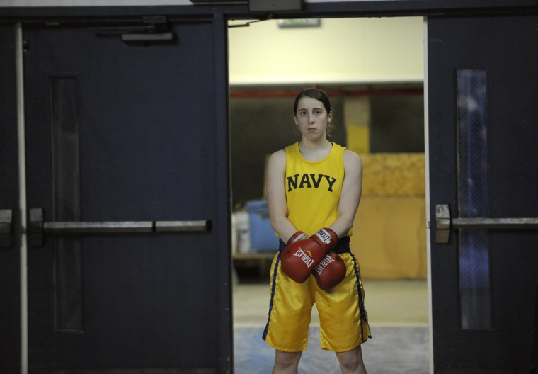 Midshipman Sam Glaeser waits for her 139 pound bout to begin. As part of the academy's physical education all midshipmen are required to participate in boxing. (Lloyd Fox/Baltimore Sun)